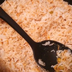 Simple Spiced Rice Recipe - Simple basmati rice, with its subtle, flowery fragrance, cooks up light and fluffy with cinnamon sticks and a bay leaf to make a perfect side dish for so many meals.