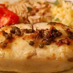 Capers and Halibut Recipe - This is a very easy seared halibut with a buttery wine and caper sauce! It takes hardly any time at all to make, but it is sure to leave a lasting impression.