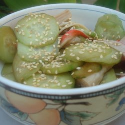 Sunomono (Japanese Cucumber and Seafood Salad) Recipe - Cucumbers and imitation crabmeat are lightly marinated in rice vinegar to make this cool and tasty salad.