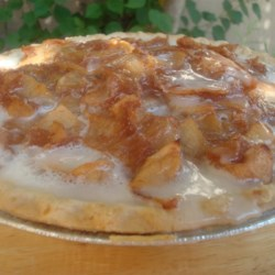 Deluxe Apple Pie Bake Recipe - An open-face apple pie filled with apples, raisins, walnuts. All topped off with a drizzling of sweet icing.