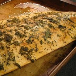 Herbed Salmon Recipe - I began using sage on salmon during my college years, when I grew entirely too much of the herb, and put it in pretty much everything. It became my favorite herb, and lends a delicate and unexpected taste and scent to this dish.