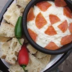 White Pizza Dip Recipe - This is a delicious garlic dip.  Mix your favorite pizza toppings into the mixture before baking, to add extra flavor.
