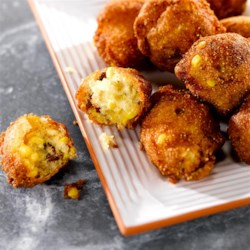 Fresh Corn Fritters Recipe - Fresh corn kernels, crumbled bacon and sour cream bring delicious flavor to these quick deep-fried corn fritters.