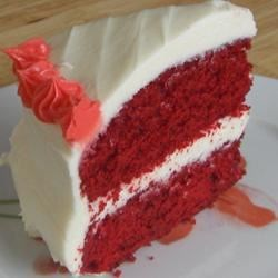 Red Velvet Cake II Recipe - This recipe makes a red cake frosted with cream cheese frosting to stand as a bright spot on your holiday table.