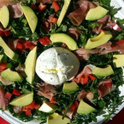 Avocado Burrata Salad Recipe - Baby arugula and prosciutto tossed with a balsamic vinaigrette dressing are topped with a creamy ball of fresh burrata, avocado slices and chopped Roma tomatoes for this quick lunch salad.
