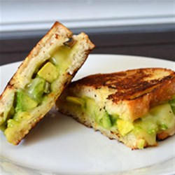 Creamy Jack Grilled Cheese with Fruit-Glazed Avocado Recipe - Delicious creamy Monterey Jack cheese melts smoothly over fresh, gently sweetened, cubed avocados on crispy grilled country bread.