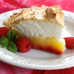 Raspberry Lemon Meringue Pie Recipe - A layer of raspberries and extra lemon are added to the traditional lemon meringue pie for a tangy and sweet dessert for any special occasion.