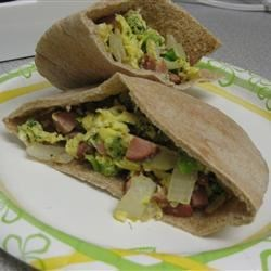 Quick Breakfast in a Pita Recipe - Pita bread sandwiches with scrambled eggs and potatoes. Very quick. I sometimes make it for myself when I'm rushed. This recipe is great for using up leftovers, and is very versatile: you can add any other seasonings you like, and you can use egg substitute if you prefer.