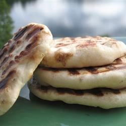 Naan Recipe and Video - This recipe makes the best naan I have tasted outside of an Indian restaurant. I can't make enough of it for my family. I serve it with shish kabobs, but I think they would eat it plain.