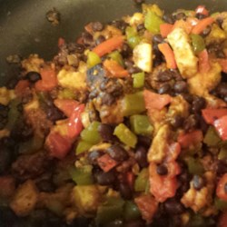 Tex Mex Stir Fry Recipe - Use a Chinese cooking technique on Mexican-inspired ingredients for a quick, tasty dinner of boneless chunks of chicken breast, red and green peppers, salsa, and black beans. Serve it on rice, and top it with Cheddar cheese.