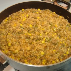 Beefy Spanish Rice  Recipe - Dinner in one pot! Ground beef and rice are briefly sauteed with onion and bell pepper, then simmered with sweet corn and tomato sauce.