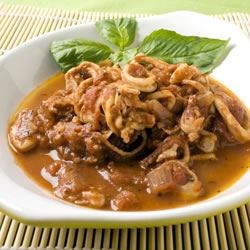 Calamari in Red Wine and Tomato Sauce Recipe - Serve this delicious dish as an appetizer with crusty bread, or as a main dish over pasta.