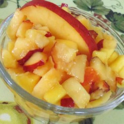 Alyssa's Mango Peach Salsa Recipe - This simple combination of diced mango and peach is a quick solution to your fruit-sauce needs. Puree for an ice cream topping!