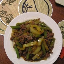 Asian Ground Beef and Pepper Saute Recipe - This ground beef dish is served over jasmine rice and combines the flavors of garlic, soy, and ginger with a hint of heat. A perfect one dish meal!