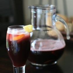 Sassy Sangria Recipe - Red wine with pineapple, orange, lime and sugar in sweet punch.