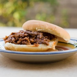 Southern Pulled Pork Recipe - This recipe starts out on the stove, and ends up in the slow cooker!  Add your favorite BBQ sauce and eat plain or on a bun! Great for parties.