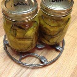Zucchini Pickles Recipe - Pickle that big crop of zucchini in your late-summer garden with an easy, sweet, and tangy recipe that tastes like bread-and-butter pickles.