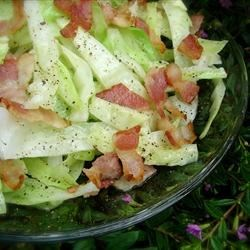 Fried Cabbage II Recipe - Cabbage and onions are sauteed in bacon grease, and served with a splash of vinegar, for a tangy, hearty dish that will surprise you.
