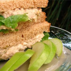 Darra's Famous Tuna Waldorf Salad Sandwich Filling Recipe - Tuna salad gets the all-star treatment when studded with tart apples, crunchy walnuts, crisp celery and savory shallots and tucked into a flaky croissant, topped with a slice of Swiss cheese.