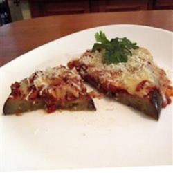 Healthy Eggplant Parmesan (No Frying Required) Recipe - No frying required to make this lighter version of the traditional Italian eggplant Parmesan, topped with a homemade tomato sauce and Gouda cheese.