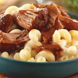 BBQ Pork Mac n' Cheese Recipe - Take amazing to the next level with Barbecue Pork Mac n' Cheese. Creamy fontina cheese and slow-cooked pulled pork will make this dish your new favorite comfort food.