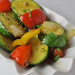 Garlic Vegetable Saute Recipe - A delicious mix of fresh zucchini and yellow and red bell peppers are cooked in butter and olive oil. Jalapeno pepper and garlic add a fragrant zing.