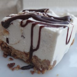 "Alaskan Peanut Butter Ice Cream Pie Recipe - This recipe creates a simple peanut butter-flavored pie ""crust"" for filling with softened ice cream."