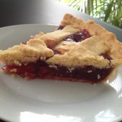Cherry Pie IV Recipe - Sour cherries and a hint of almond extract flavor this simple, classic cherry pie with a homemade crust.