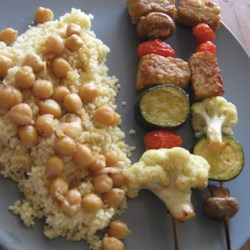 Tempeh Kabobs with Moroccan Couscous Recipe - Soaked in a delectable honey soy marinade, and paired with grilled vegetables and a Moroccan-style couscous, both meat eaters and vegetarians will enjoy this dinner.