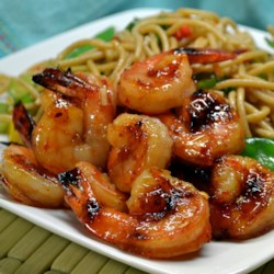 Sweet and Spicy Grilled Shrimp Recipe - Basting shrimp on the grill with a sauce made with honey and chile-garlic sauce delivers flavorful results.