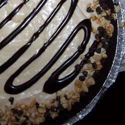 Nutty Buddy Pies Recipe - Just like an peanutty ice cream bar, but in the shape of a pie! Cream cheese, crunchy peanut butter, powdered sugar, whipped topping and chocolate syrup create a creamy, crunchy, chocolatey frozen dessert pie!