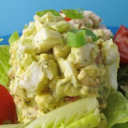 Loaded Egg Salad Recipe - This egg salad is packed with bacon, celery, onion, and relish. A hit of chile-garlic sauce lends a bit of heat.