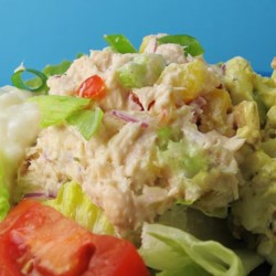 Creamy and Crunchy Tuna Salad Supreme Recipe - Cream cheese makes this tuna salad rich and creamy, diced carrot makes it crunchy, and red bell pepper makes it pretty. Add baby spinach or lettuce leaves, and serve on your favorite bread or as a wrap in a tortilla.