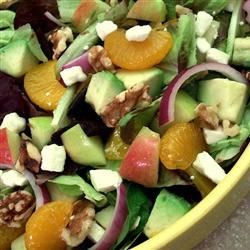 Apple Avocado Salad with Tangerine Dressing Recipe - This tossed green salad with apples, avocados, and walnuts simply sparkles with a marvelous mandarin orange juice dressing!