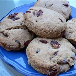 Cranberry Orange Wheat Scones Recipe - These scones are a delicious and nutritious snack that is wonderful when warm with some butter.  They are also good for freezing, on the go eating and they'll be sure to please guests who stop by.  Yummy!