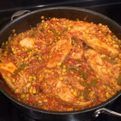Spanish Rice Chicken II Recipe - Chicken, vegetables, rice and tomatoes simmer with just the right seasonings that keeps them coming back for more.