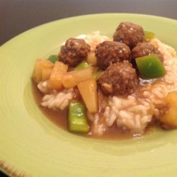 Sweet and Sour Meatballs IV Recipe - Beef meatballs simmered in a sauce of brown sugar, lemon and pineapple juice, with chopped green pepper and pineapple chunks. Great served over rice.