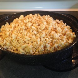 Cajun-Spiced Popcorn Recipe - Popcorn is roasted with butter and a blend of spices to make an addictive snack. I make this for watching movies or even sports.