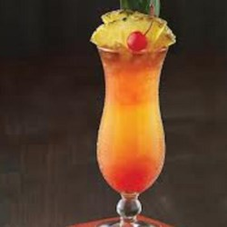 Bahama Mama Celebration Drink Recipe - Add Caribbean sizzle to your summertime drink repertoire with this rum-based cocktail combining orange and pineapple juices, coconut rum, vanilla liqueur, and grenadine syrup.