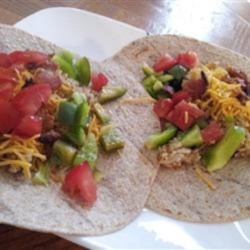 Bacon Tacos Recipe - Bacon joins forces with rice, beans, and tortillas creating a delicious duo: bacon tacos!