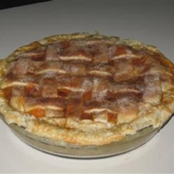 Rustic Apricot Pie Recipe - Sweet apricot pie, made with freshly picked apricots and topped with a lattice crust, is the perfect summer dessert.
