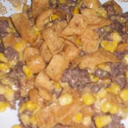Squat Corn (a.k.a. 'Skillet Fritos(R)') Recipe - This campfire recipe moves to your kitchen, allowing you to have a savory mixture of ground beef, corn, processed cheese food, and corn chips all in one tasty dish.