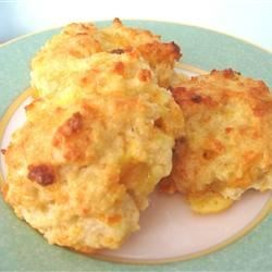 Cheddar Biscuits Recipe - Buttermilk baking mix does the trick in these savory biscuits, with the addition of Cheddar cheese, garlic, parsley and milk.