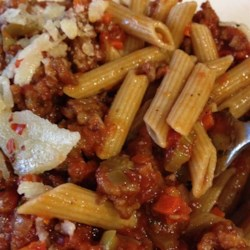 Mom's Spaghetti Bolognese Recipe - This version of a classic Italian dish combines bacon with ground beef and canned crushed tomatoes in a sauce to be served over spaghetti.