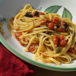 Island Style Linguine Recipe - This quick, island-style linguine features garlic that is slowly simmered to golden perfection in olive oil, then mixed with tomatoes, capers, olives, and a combination of herbs and poured over linguine.