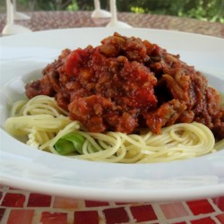 Ma Hunsicker's Spaghetti Sauce Recipe - This delicious, meaty, Italian pasta sauce is so good, you'll not mind having to wait while letting it simmer for a few hours.