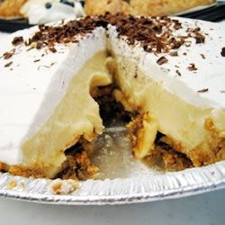 Banana Cream Pie with Chocolate Lining Recipe - How can you resist this decadent pie that is a graham cracker crust lined with bittersweet chocolate and filled with a custardy banana filling? And after two hours in the fridge, this pie gets even better when topped with whiskey whipped cream.