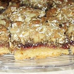 Grandma's Raspberry Bars Recipe - A crust of butter, sugar and flour is layered with raspberry jam, then topped with oats  and walnuts.