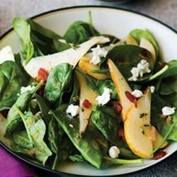 Strawberry, Spinach, and Pear Salad Recipe - Spinach leaves and romaine are tossed with balsamic vinaigrette and topped with sliced strawberries, sliced pears, toasted black walnuts, and feta cheese.