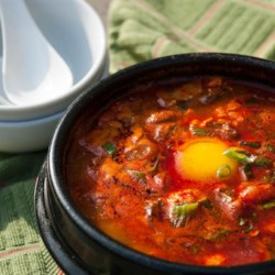 Korean Soft Tofu Stew (Soon Du Bu Jigae) Recipe - This versatile tofu stew is hearty and simple to make. Use more Korean chile powder for an added kick or toss in a few clams for an even more exotic treat.